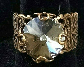 Filigree Antique Brass ring with Black Diamond Swarovski Crystal.