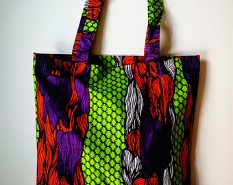 African Wax Print Fabric Tote Bag. Made in Africa. Purple, green, orange. Traditional print shopping bag.