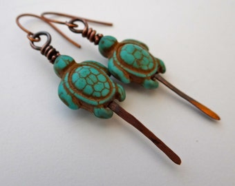 Turquoise earrings dangling wire wrapped with turtle totem talisman beads and hammered copper antiqued long turquoise with copper detail