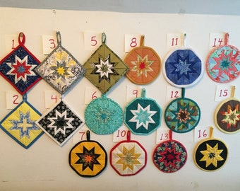 Amish folded star potholders, trivets, hot pads