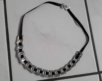 Beautiful necklace in cans, single black caps
