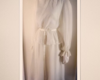 Beautiful, eloquent vintage John Charles dress in sheer chiffon with lace detailing.