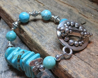 Chunky turquoise and Bali silver bracelet . Free form turquoise slices , round turquoise beads,  hand beaded , silver toggle