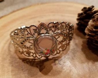 Silver tone filigree bracelet with deer/elk antlers and flowers snap