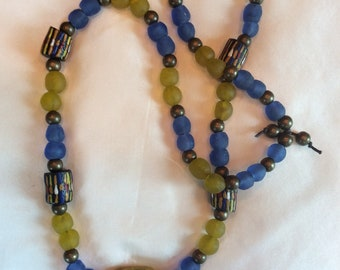 Blue and yellow krobo beads with multi-colored beads and a stone bluebird