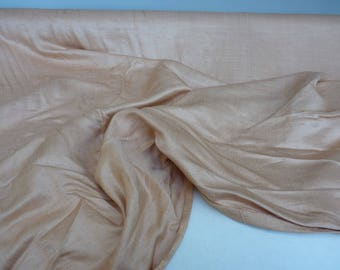 "fabric silk solid of beige, nude, brand ""Asia Silk"", irregular thick yarn in the direction of the frame."