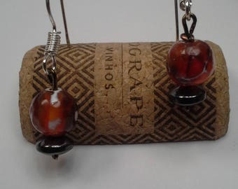 Globe earrings hang