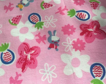 Pink fabric with little rabbits