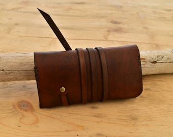 Brown leather tobacco pouch with strap