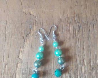 Green beaded bell earrings
