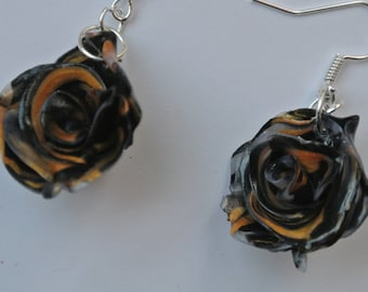pink color flower shape earrings black, gold and clear