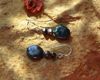Freshwater pearl dangle earrings in three colors on silver french hook ear wires.