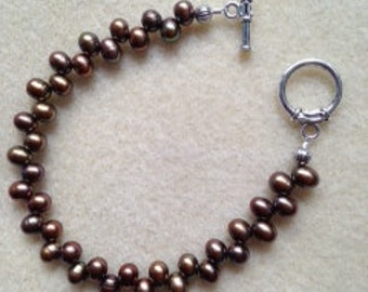 Chocolate/iradescent freshwater pearl bracelet w/ silvertone toggle