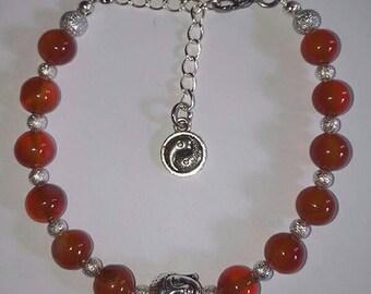 Buddha Head Charm and Carnelian Bracelet