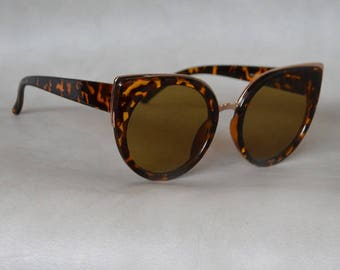Cat eye Tortouise Shell Sunglasses with Gold Detail.