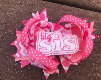 Add a big sister bow to a hat