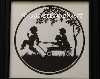 Three Boys With A Wagon   - Custom Personalized  - Scherenschnitte - Hand Paper Cutting Art signed and dated By Janet Lynch - Framed