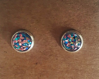 Rose and teal studs.