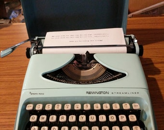 1970's aqua blue Remington Streamline portable typewriter
