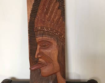 Irreverant tongue sticking out Brazilian wood carving