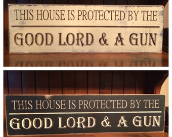 """Custom Carved Wooden Sign - """"This House Is Protected By The Good Lord & A Gun"""" - 24""""x6"""""""