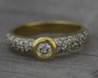 Round Cut Diamond Pave Set Engagement Ring