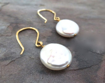 Pearl Earrings. White coin pearl earrings with gold ear wires