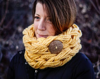 Single wrap chunky arm knit scarf w/ coconut hull button in yellow