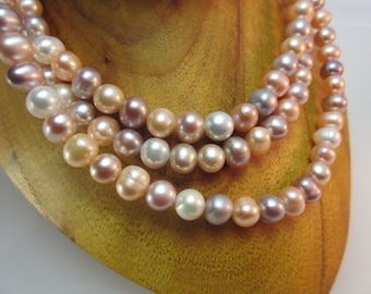 Reflecting freshwater pearl strand salmon-lilac-white 10 x 8 mm