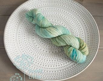 Handdyed seagreen and sandy beach hank of sports weight superwash merino wool