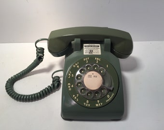 Vintage avocado green bell system rotary phone