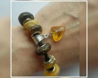Amber charm bead (heart shaped)