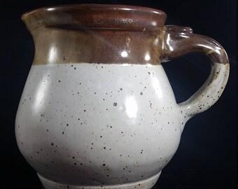 Cream and brown stoneware pitcher