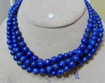 1 Strand   Lapis lazuly   polished Round  beads   15''  40, grams  7X101. MM