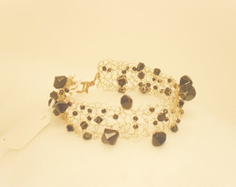 Gold and black beaded wire bracelet