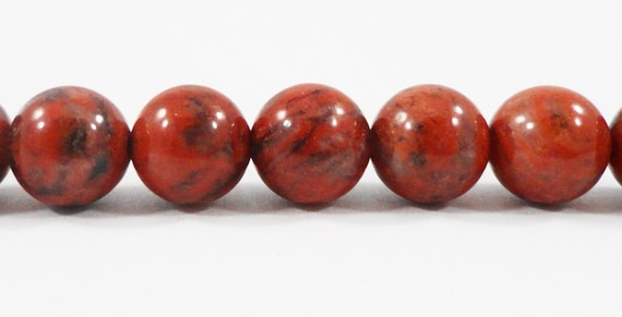 red jasper on gemstone crystals pin cabochons healing cabochon