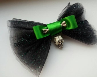 Big hairbow, made with black netting, a skull, a bone, and a green bow!