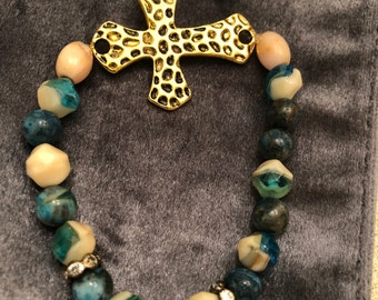 Hammered gold cross on blue and ivory glass beads