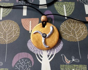 Gold and silver handmade clay circular pendant