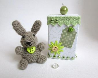 Brown crochet rabbit in its box