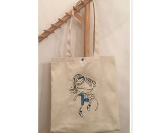 Tote bag is lined and embroidered with a football player