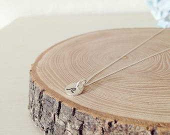 A small sterling silver disc on a sterling silver chain handstamped with your personalised message.
