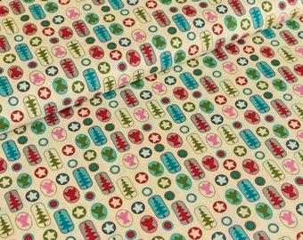 Cotton fabric joyful Christmas motifs color / crème (9,50 EUR / meter)