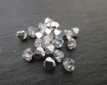 4 mm: 8 silver crystal beads Swarovski Crystal bicones