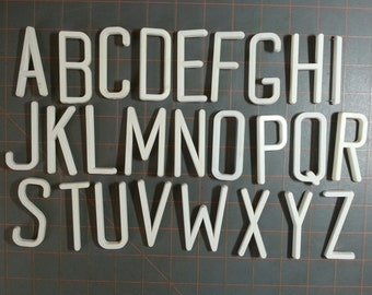 Set of 2.5 inch upper case white pin back letters for bulletin boards or crafting
