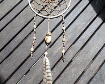 Dream catcher in natural hemp cord, mineral, feather, wood and seeds