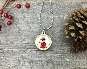 Constable Canada RCMP officer cross stitch necklace/pendant in laser cut wood frame (he's a Mountie!)