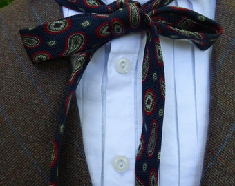 Silk, narrow necktie, 19th century style, dark blue with red and green medallions