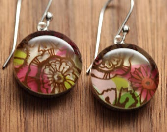 Flower earrings made from recycled Starbucks gift cards. sterling silver and resin.