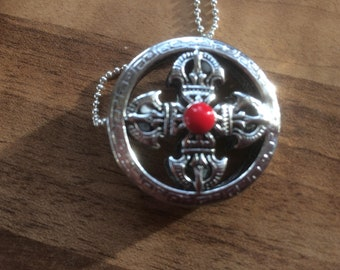 Cross shape reversible red/blue relic pendant on silver tone chain